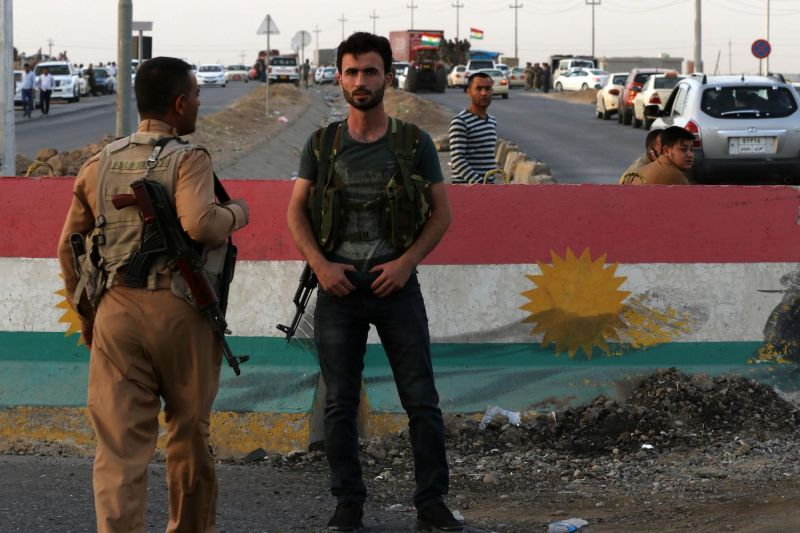Members of the Iraqi Kurdish security forces stand guard at a checkpoint in Altun Kupri, 25 miles south of Erbil, the capital of the autonomous Kurdish region of northern Iraq on Oct. 16, 2017.