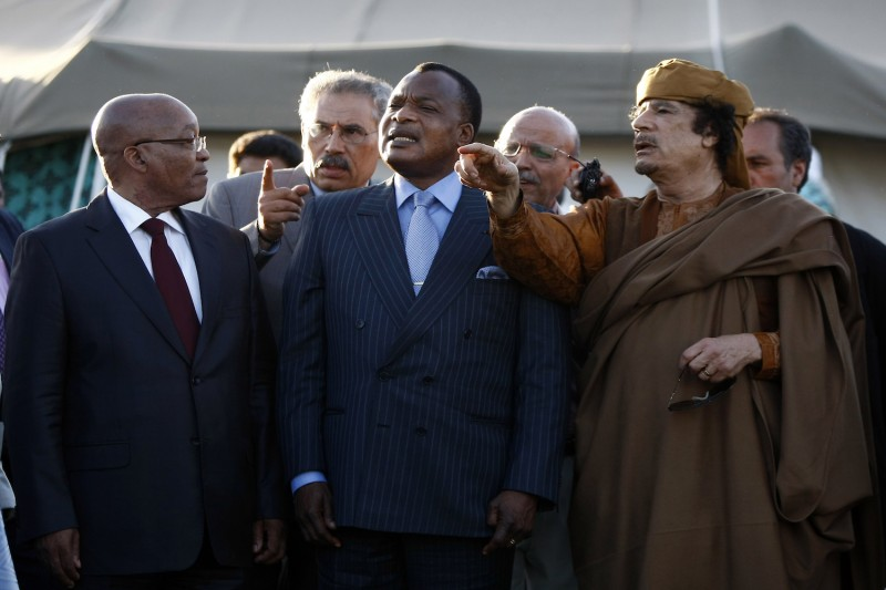 Then-Libyan leader Muammar al-Qaddafi (R) speaks with presidents Jacob Zuma of South Africa (L) and Denis Sassou Nguesso of Republic of Congo (C) in Tripoli on April 10, 2011 during a meeting with a high-ranking African Union delegation trying to negotiate a truce between Qaddafi's forces and rebels seeking to oust him.
