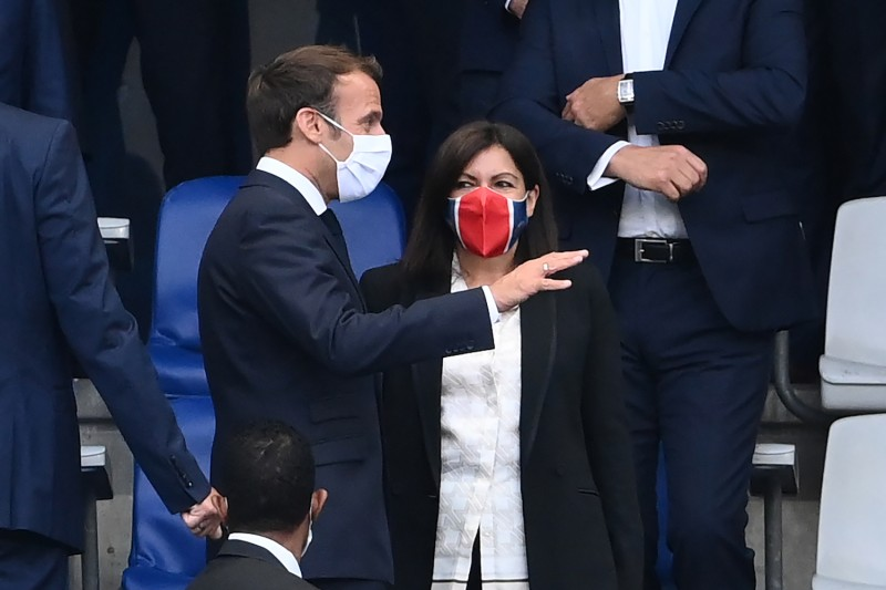 French President Emmanuel  Macron  speaks with Paris Mayor Anne Hidalgo  during the French Cup soccer match between Paris Saint-Germain and Saint-Etienne on July 24 at the Stade de France in Saint-Denis, outside Paris.