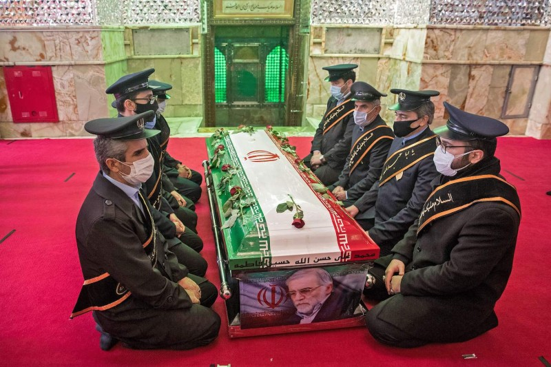 Members of the Iranian armed forces pray around the coffin of slain nuclear scientist Mohsen Fakhrizadeh during the burial ceremony in Tehran, on Nov. 30.