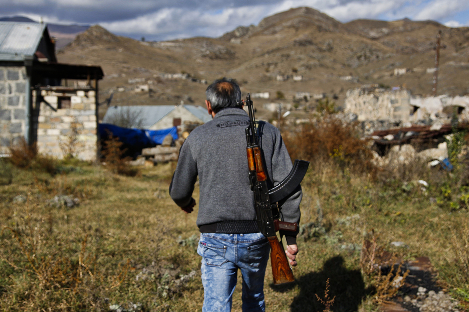 An ethnic Armenian soldier back from the frontlines around Shushi returns to his house to pack up and escape Kalbajar on Nov. 12.