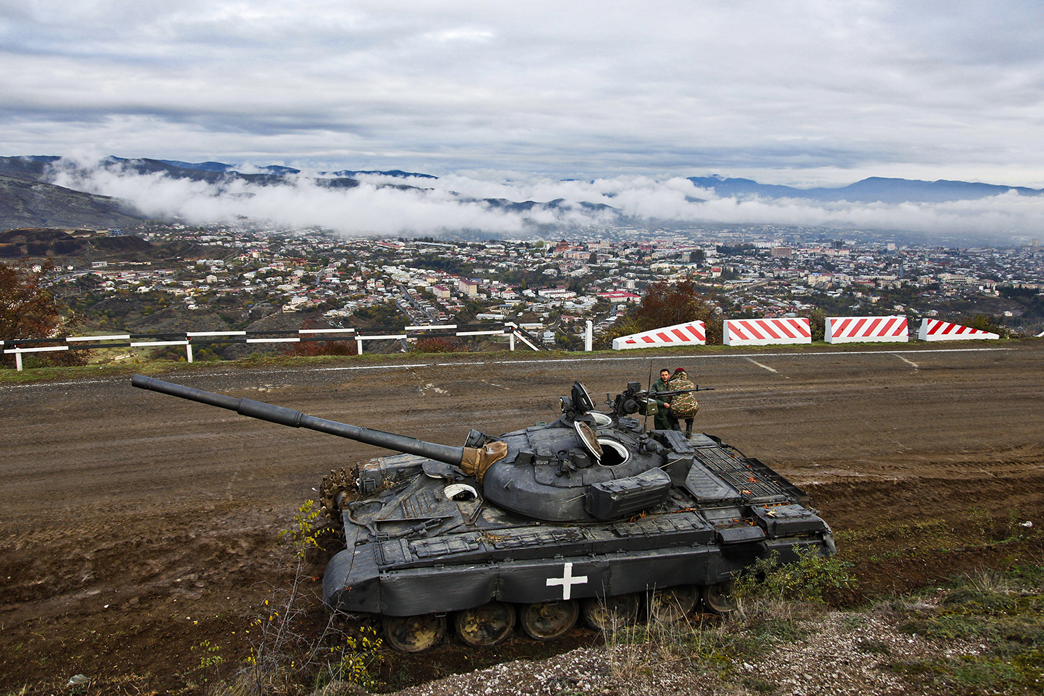 Ethnic Armenian soldiers man a tank by the highway connecting Stepanakert and Shushi in Nagorno-Karabakh on Nov. 13.