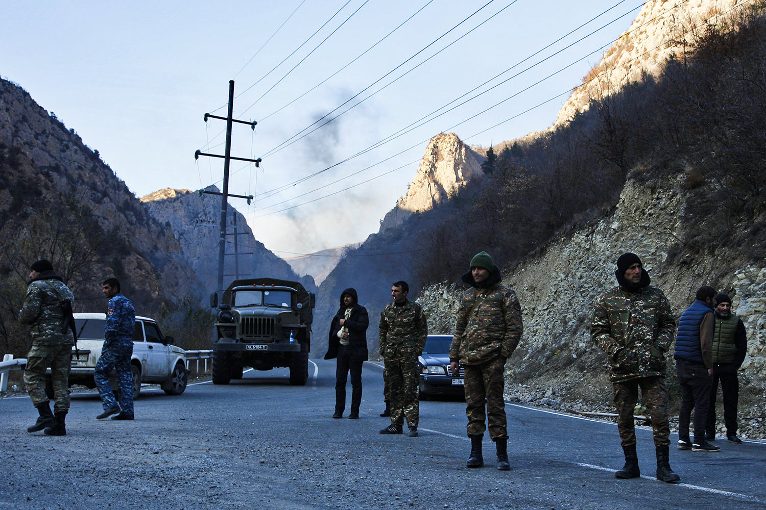Ethnic Armenian soldiers block the main northern highway in Nagorno-Karabakh on November 14, 2020, forcing traffic to take a smaller, rougher road through Kalbajar.