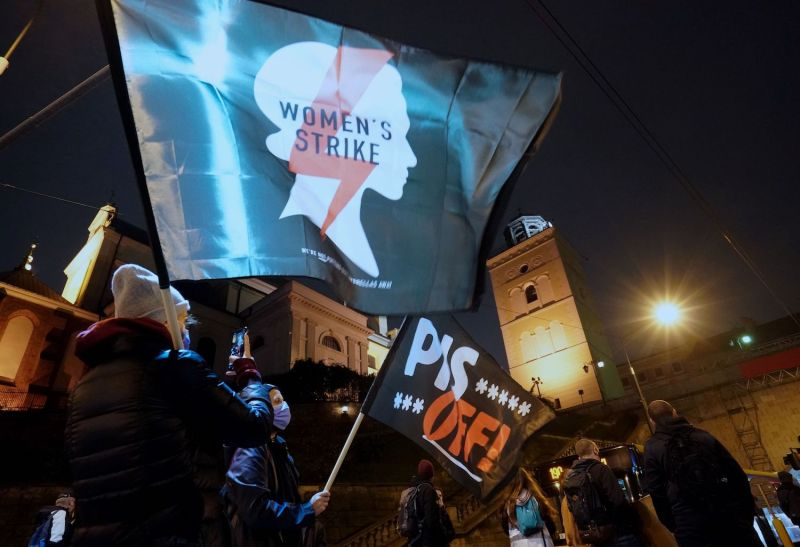 Demonstrators wave flags as they block a street during a protest against the tightening of Poland's already restrictive abortion law on Nov. 2 in Warsaw.