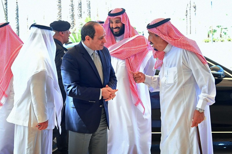 Saudi King Salman (R) and Saudi Crown Prince Mohammed bin Salman (C) receive Egypt's President Abdel Fattah al-Sisi at the Neom site near Maqnah, Saudi Arabia on Aug. 14, 2018.