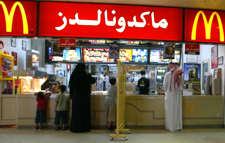 A segregation board separates men and women at a McDonald's in Riyadh, Saudi Arabia, on July 11, 2004.