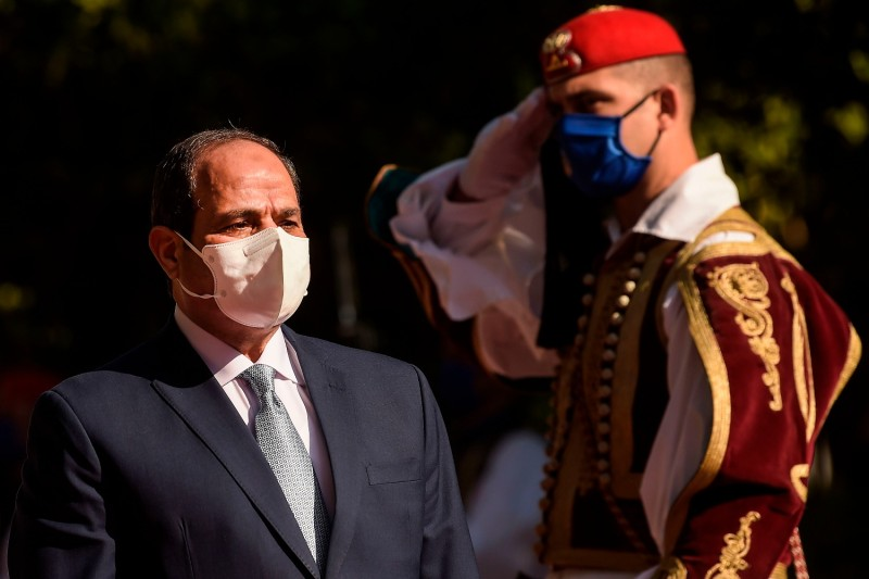 Egyptian President Abdel Fattah al-Sisi walks by the Greek Presidential Guard before meeting with Greek President Katerina Sakellaropoulou in Athens on Nov. 11.