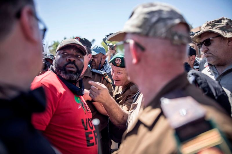Members of the Economic Freedom Fighters and members of the Afrikaner survivalist group Kommandokorps argue in Senekal, South Africa, on Oct. 16.