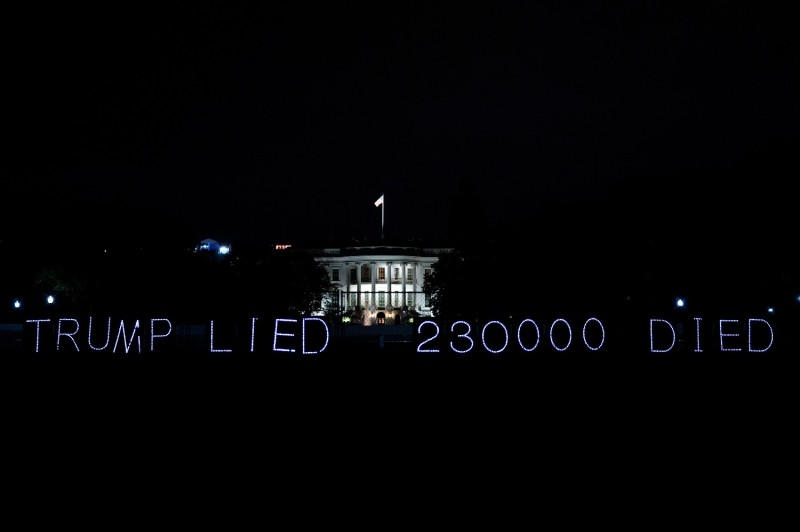 A sign marking 230,000 coronavirus deaths in the United States is displayed outside the White House in Washington on Oct. 31.