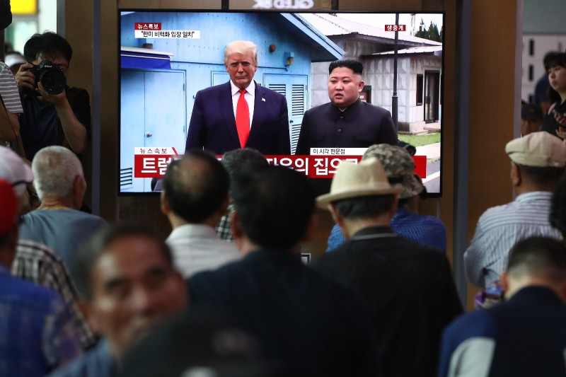 South Koreans in the Seoul Railway Station watch on screen as U.S. President Donald Trump meets with North Korean leader Kim Jong Un at the Demilitarized Zone separating the two countries on June 30, 2019.