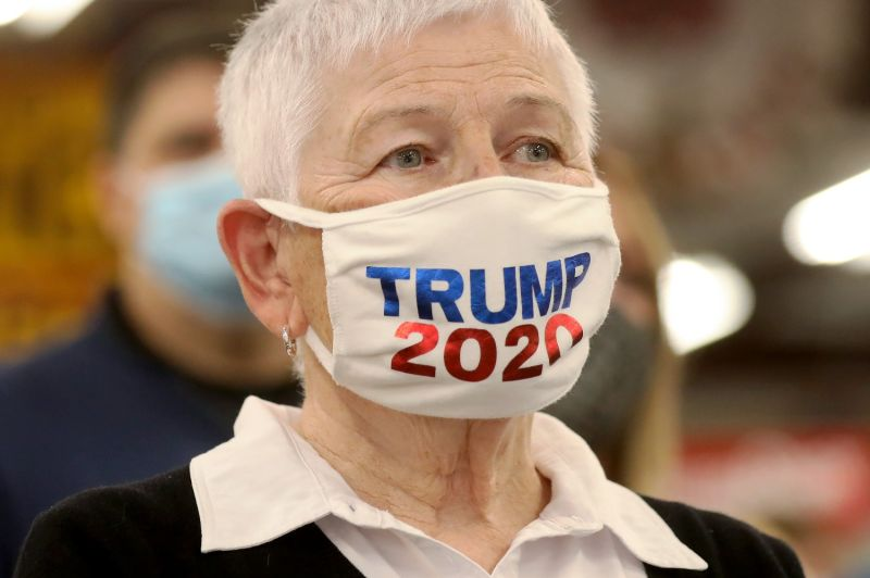 "A woman wears a ""Trump 2020"" face mask at a rally for incumbent Republican Senate candidate Joni Ernst in Davenport, Iowa, on Oct. 31."