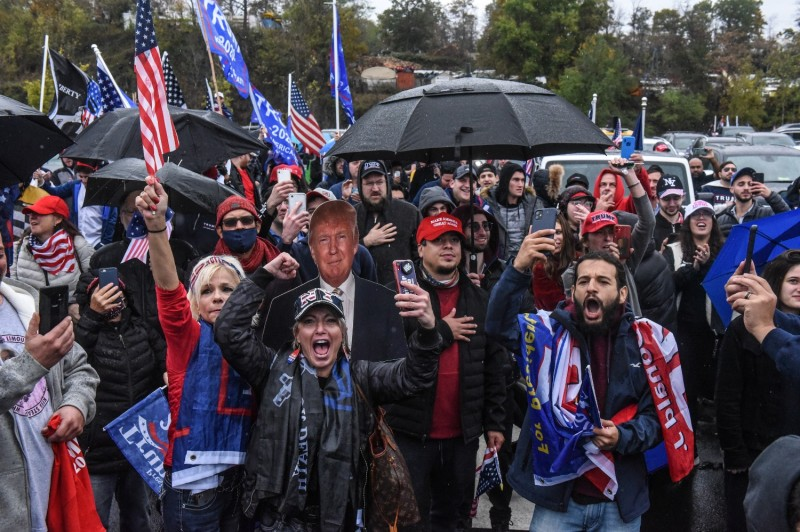Supporters of U.S. President Donald Trump cheer during a rally in West Nyack, New York, on Nov. 1.