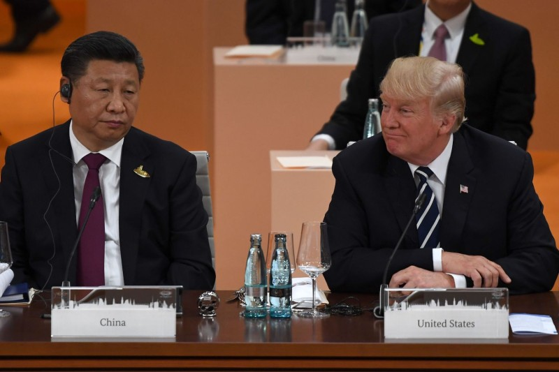 Chinese President Xi Jinping and U.S. President Donald Trump attend a working session on the first day of the G-20 summit in Hamburg, Germany, on July 7, 2017.