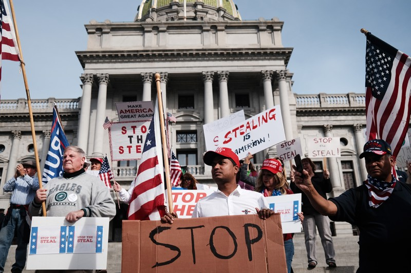 Dozens of supporters of U.S. President Donald Trump call for stopping the count of ballots in Pennsylvania at the State Capitol in Harrisburg on Nov. 5.