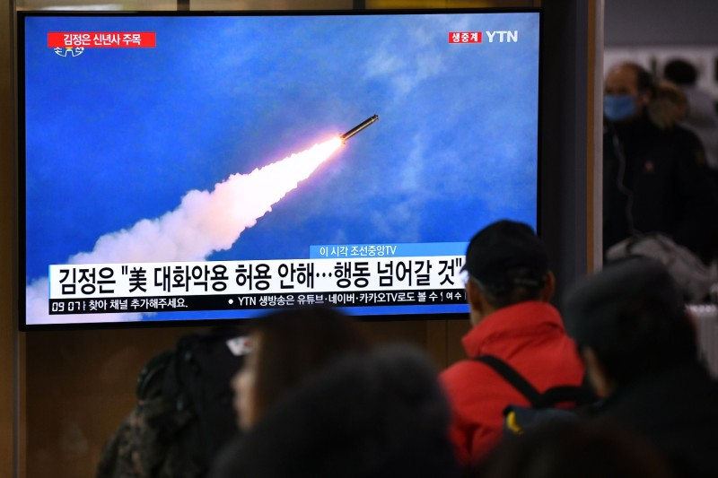 People watch a television  showing footage of a North Korean missile test, at a railway station in Seoul, on Jan. 1, 2020.