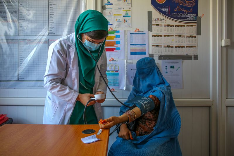 A doctor measures the blood pressure of a patient at the Kahdistan health clinic in Herat province, Afghanistan, on Oct. 7. The increasing presence of midwives across the country has started to play a role in improving a mother's and baby's chances of survival. Afghanistan's maternal mortality rate has dropped from 1,300 deaths per 100,000 live births in 2002 to 638 deaths per 100,000 births in 2017.