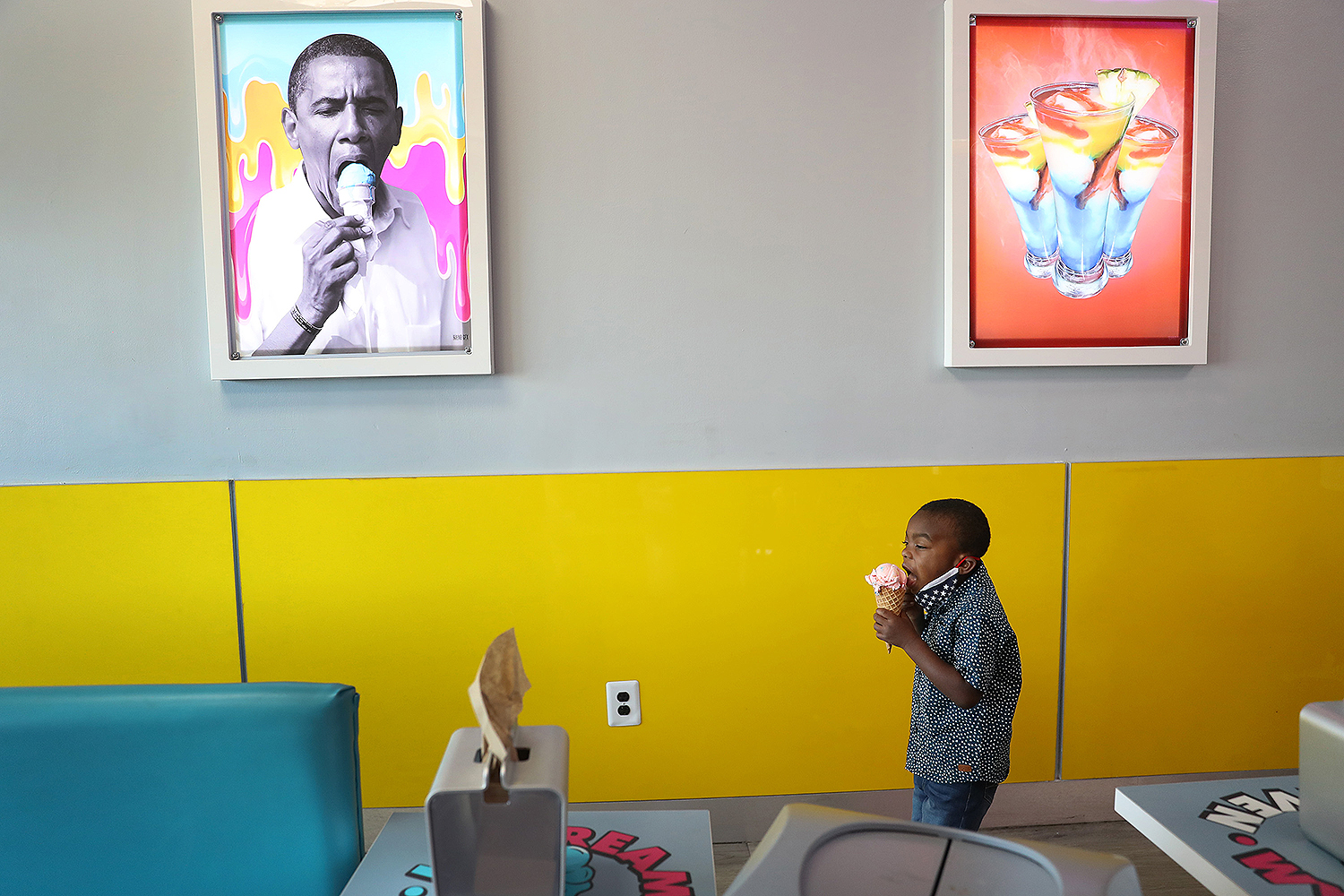 A refreshing treat. Charistan Hood, 4, eats ice cream near a picture of former President Barack Obama at the Black-owned store Ice Cream Heaven in Miami Gardens, Florida, on July 7, Blackout Day. Supporters of Blackout Day committed to spending money only at Black-owned businesses to showcase the economic power of the Black community. Joe Raedle/Getty Images