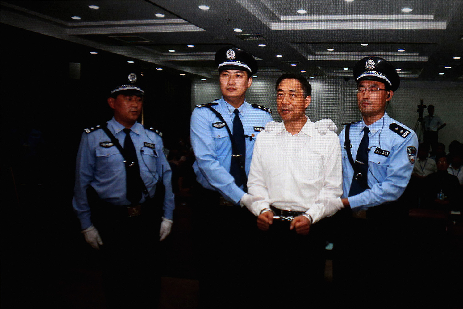 A screen shows the sentencing of Bo Xilai in Beijing on Sept. 2, 2013. The former Chinese politician was sentenced to life imprisonment for bribery, embezzlement, and abuse of power.