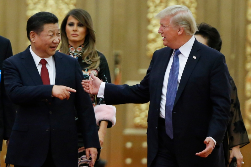 U.S. President Donald Trump and his Chinese counterpart, Xi Jinping, arrive at a state dinner at the Great Hall of the People in Beijing on Nov. 9, 2017.