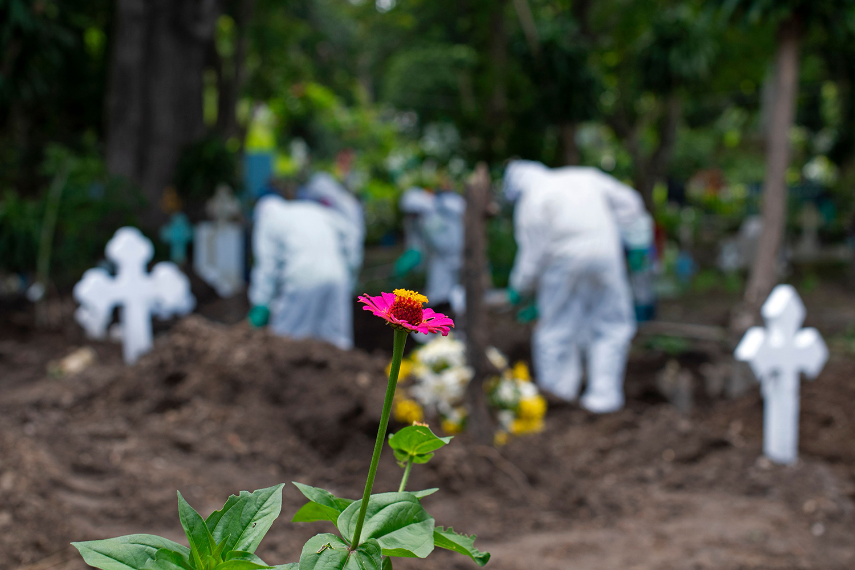 Gravediggers work at the municipal cemetery in Santa Tecla, El Salvador, on June 22. YURI CORTEZ/AFP via Getty Images