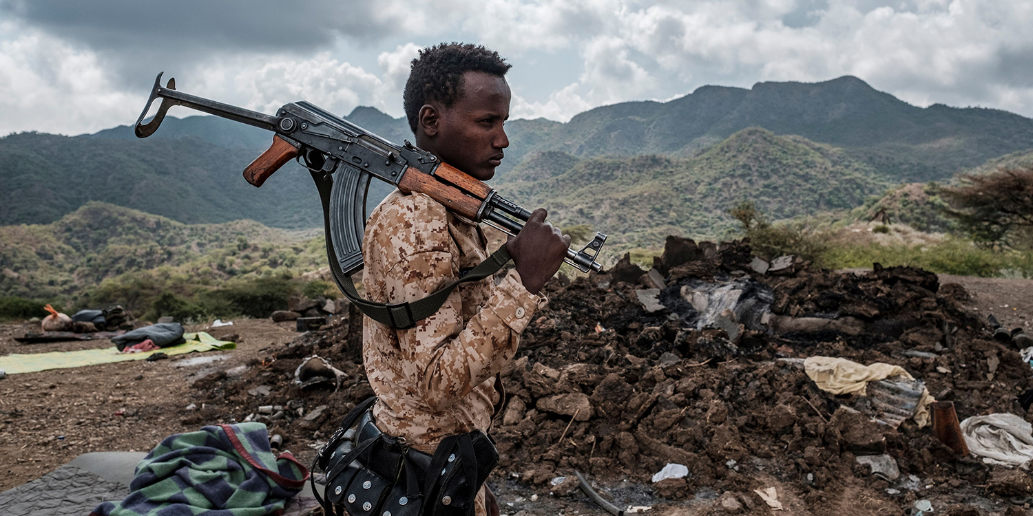 A member of the Afar Special Forces stands in front of the debris of a house on the outskirts of the village of Bisober, Tigray Region, Ethiopia, on Dec. 9. Several houses in the village were damaged during confrontations between the Tigray Forces and Ethiopian Defense Forces.