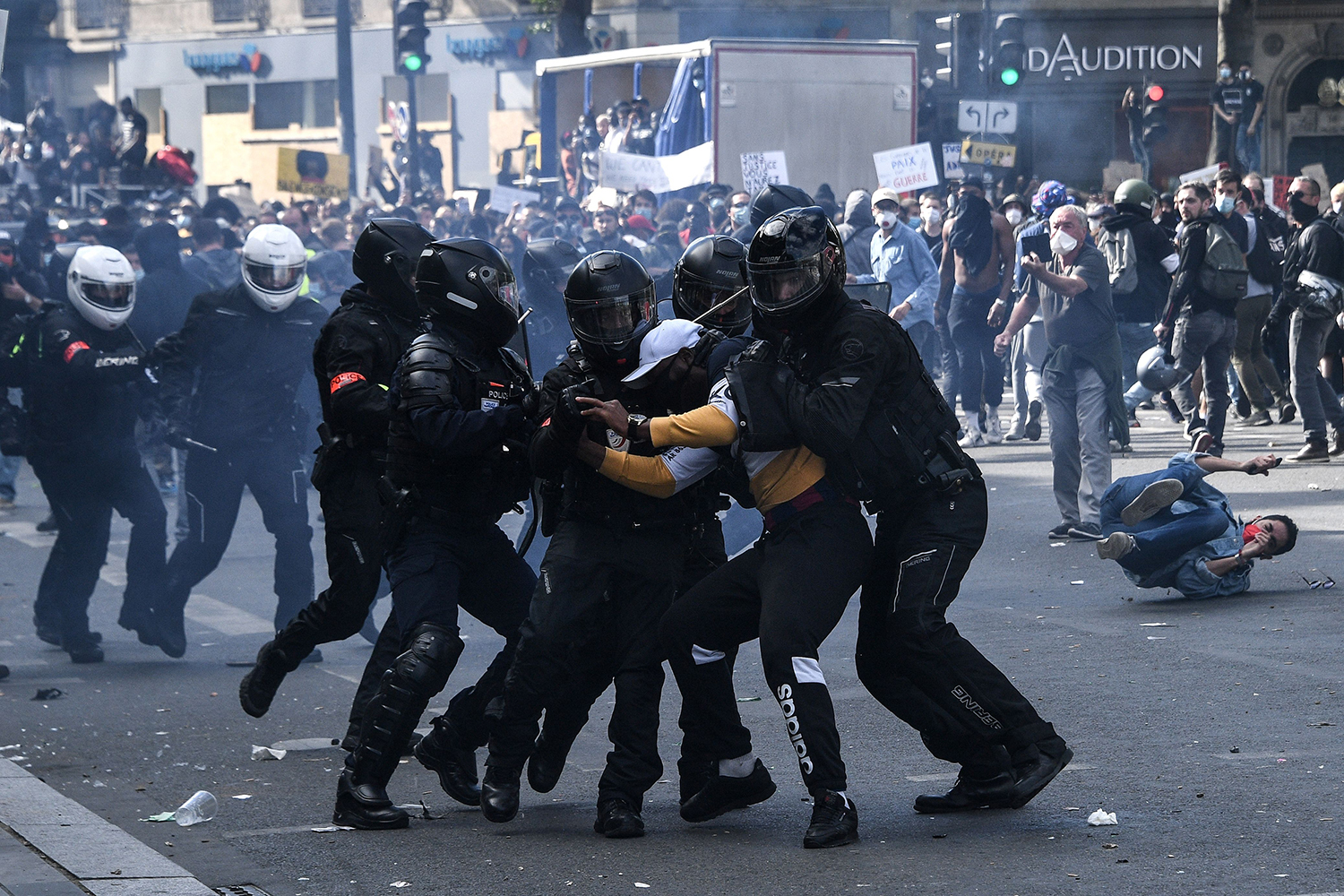 French riot police detain a protester during one of many Black Lives Matter worldwide protests against racism and police brutality on Place de la Republique in Paris on June 13. A wave of global protests in the wake of George Floyd's fatal arrest magnified attention on the 2016 death in French police custody of Adama Traore, a 24-year-old Black man. ANNE-CHRISTINE POUJOULAT/AFP via Getty Images
