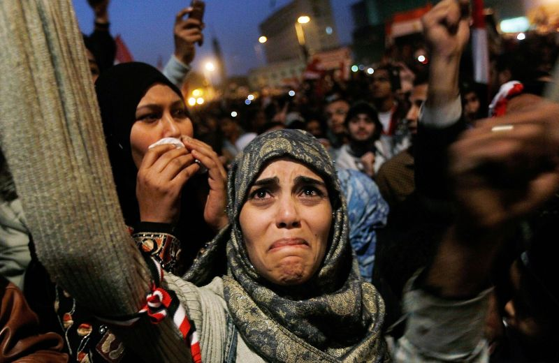 A woman cries in Tahrir Square after it is announced that Egyptian President Hosni Mubarak was giving up power Feb. 11, 2011 in Cairo, Egypt.