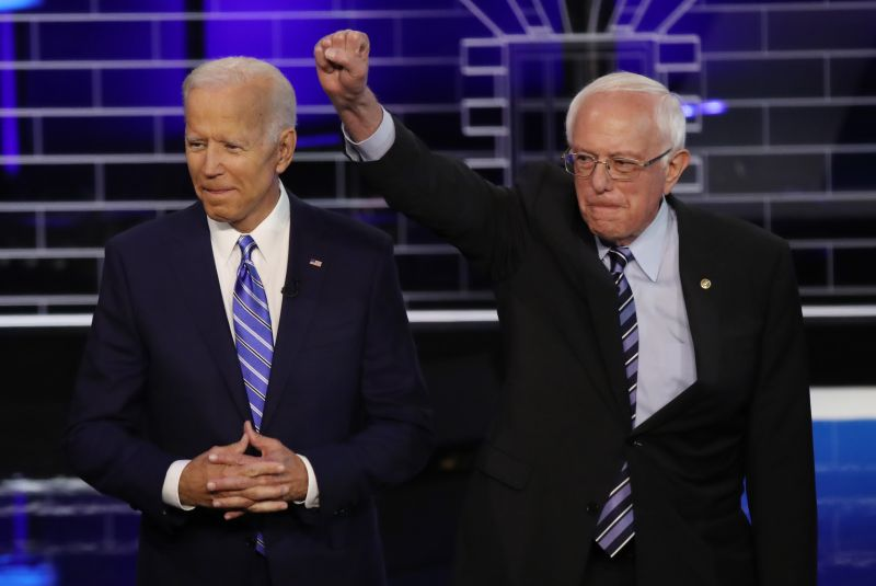 Joe Biden and Sen. Bernie Sanders (I-VT) take the stage for the second night of the first Democratic presidential debate on June 27, 2019 in Miami, Florida.
