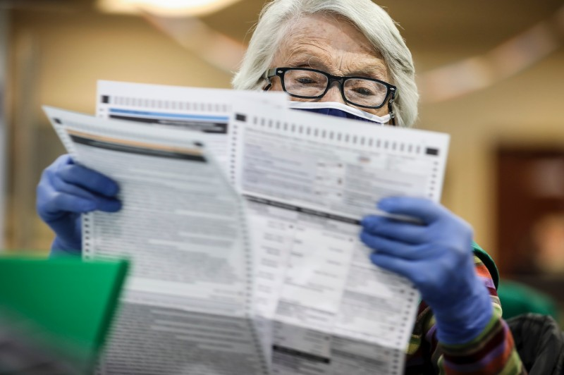 Election judge Bonnie Carr looks over ballots as she prepares them to be counted at the Denver Elections Division Building in Denver on Nov 3.