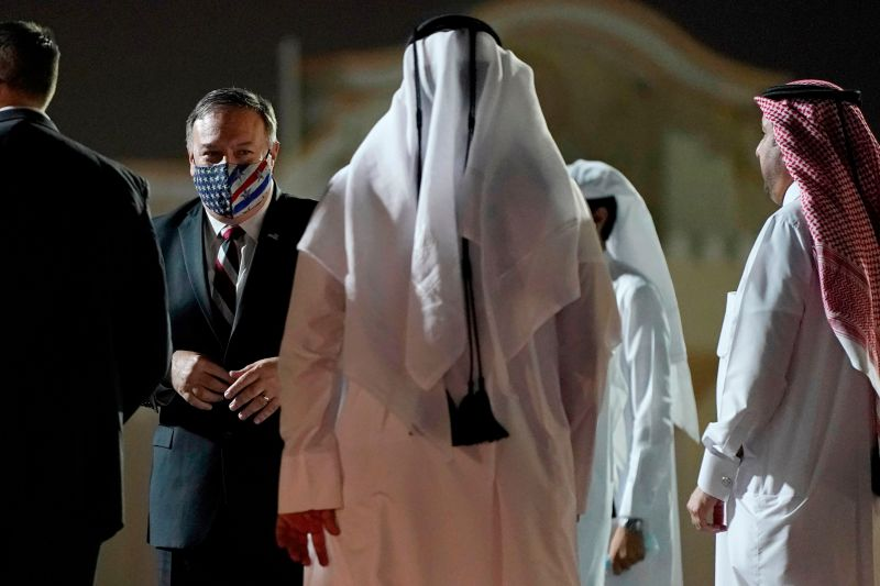 Secretary of State Mike Pompeo prepares to board his plane at the Old Doha International airport in the Qatari capital Doha, on Nov. 21, 2020.