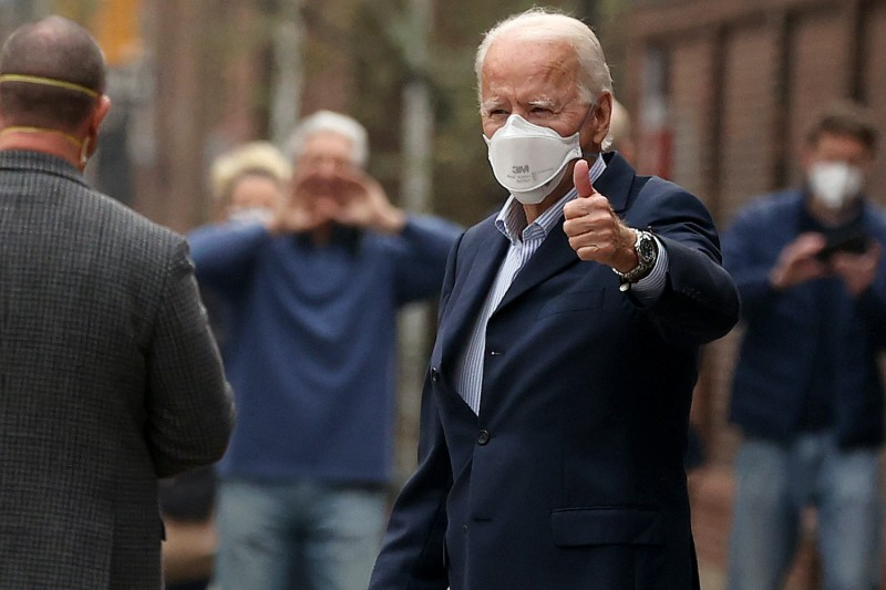 U.S. President-elect Joe Biden gives a thumbs-up as he leaves Pennsylvania Hospital after a follow up appointment at the radiology department December 12 in Philadelphia, Pennsylvania.