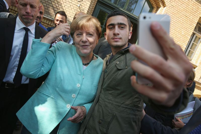 German Chancellor Angela Merkel poses for a selfie with Anas Modamani, a refugee from Syria, after she visited the AWO Refugium Askanierring shelter for migrants and refugees on Sept. 10, 2015 in Berlin, Germany.