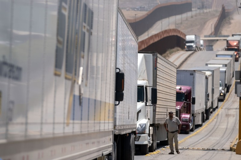 Cargo truck drivers line up to cross into the United States in Tijuana, Mexico, on June 6, 2019.