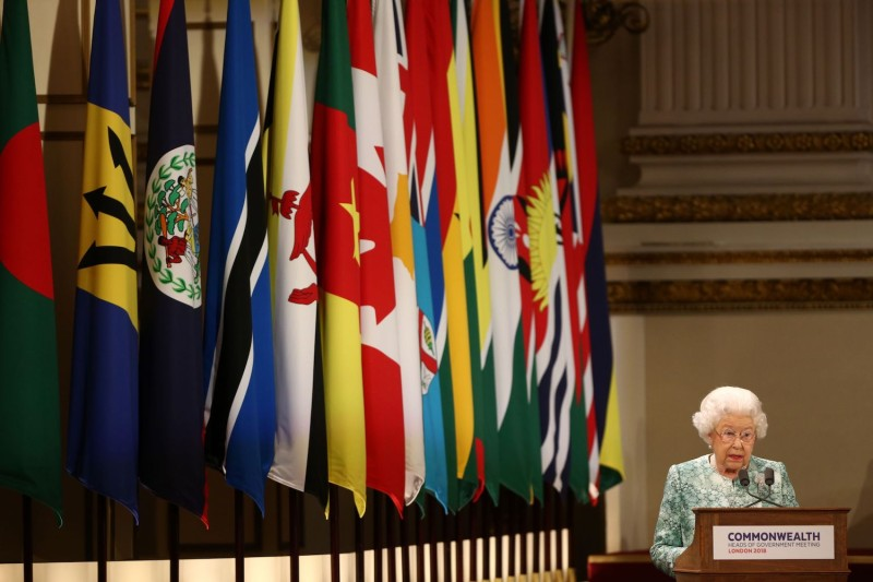 Britain's Queen Elizabeth II speaks at the formal opening of the Commonwealth Heads of Government Meeting at Buckingham Palace in London on April 19, 2018.