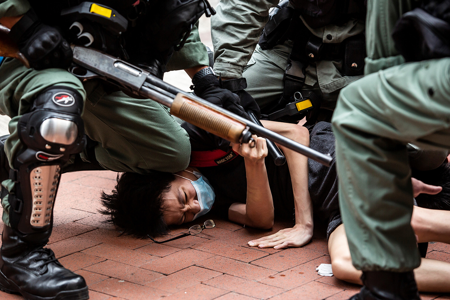 A pro-democracy protester is arrested by police in the Causeway Bay district of Hong Kong on May 24, as a proposal to enact new security legislation in Hong Kong is debated. Four days later, China's National People's Congress approved the proposal, which is expected to ban treason, subversion, and sedition. ISAAC LAWRENCE/AFP via Getty Images