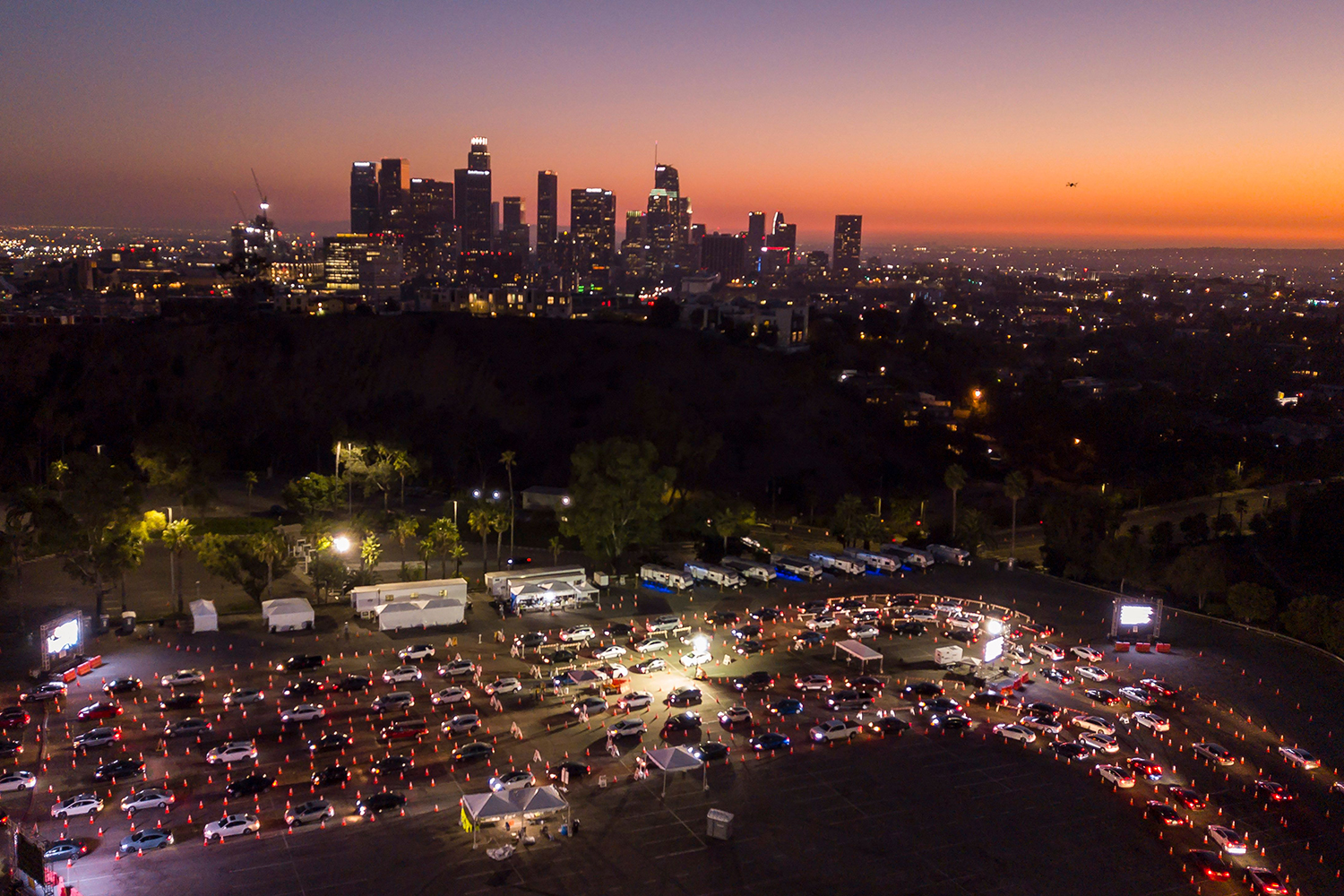 Cars line up for COVID-19 testing in the Dodger Stadium parking lot in Los Angeles on Nov. 14. After California passed 1 million coronavirus cases, a travel advisory was issued urging a two-week quarantine for those arriving from other states or countries. ROBYN BECK/AFP via Getty Images