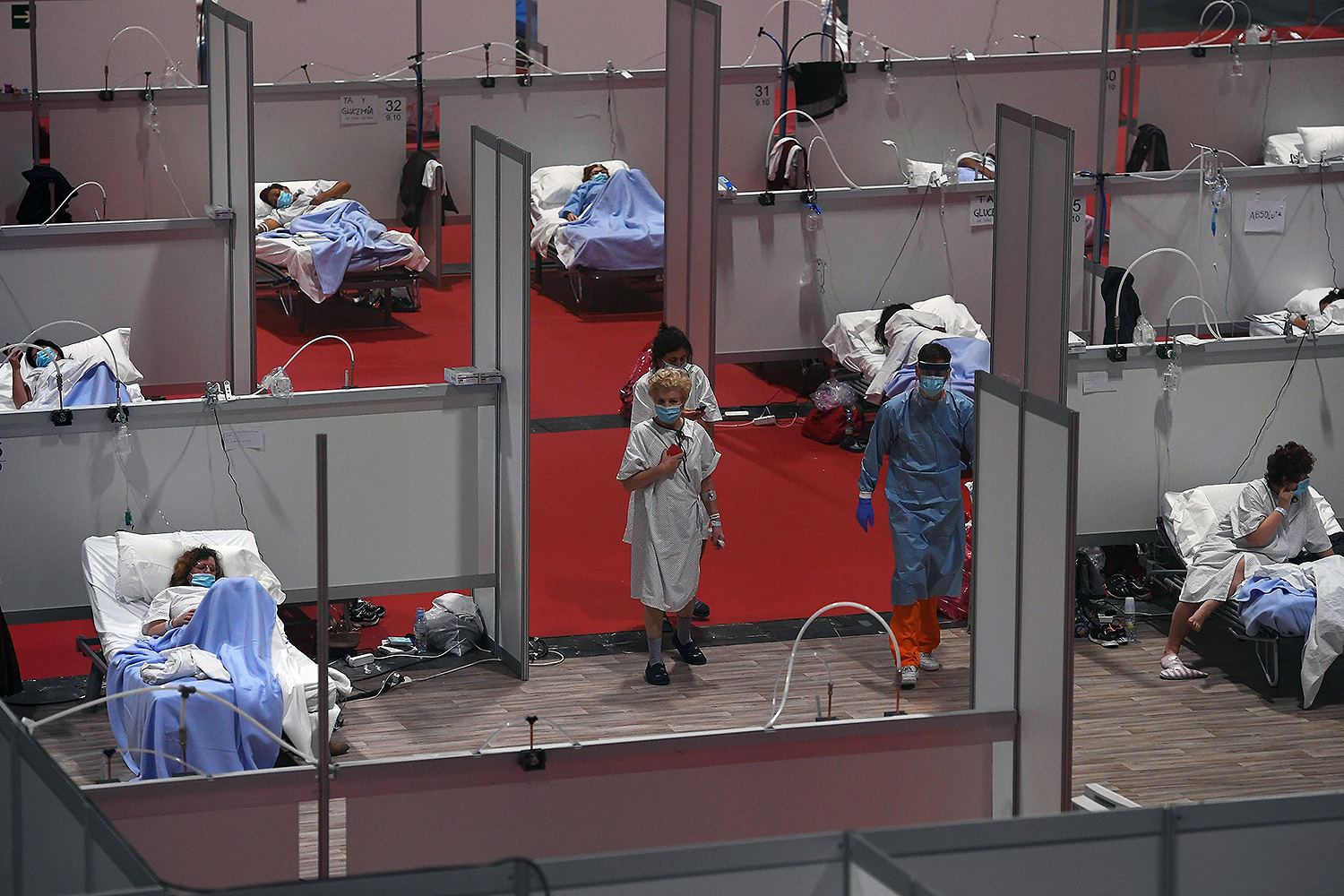 A temporary hospital for COVID-19 patients is set up at a convention center in Madrid on April 3.  PIERRE-PHILIPPE MARCOU/AFP via Getty Images