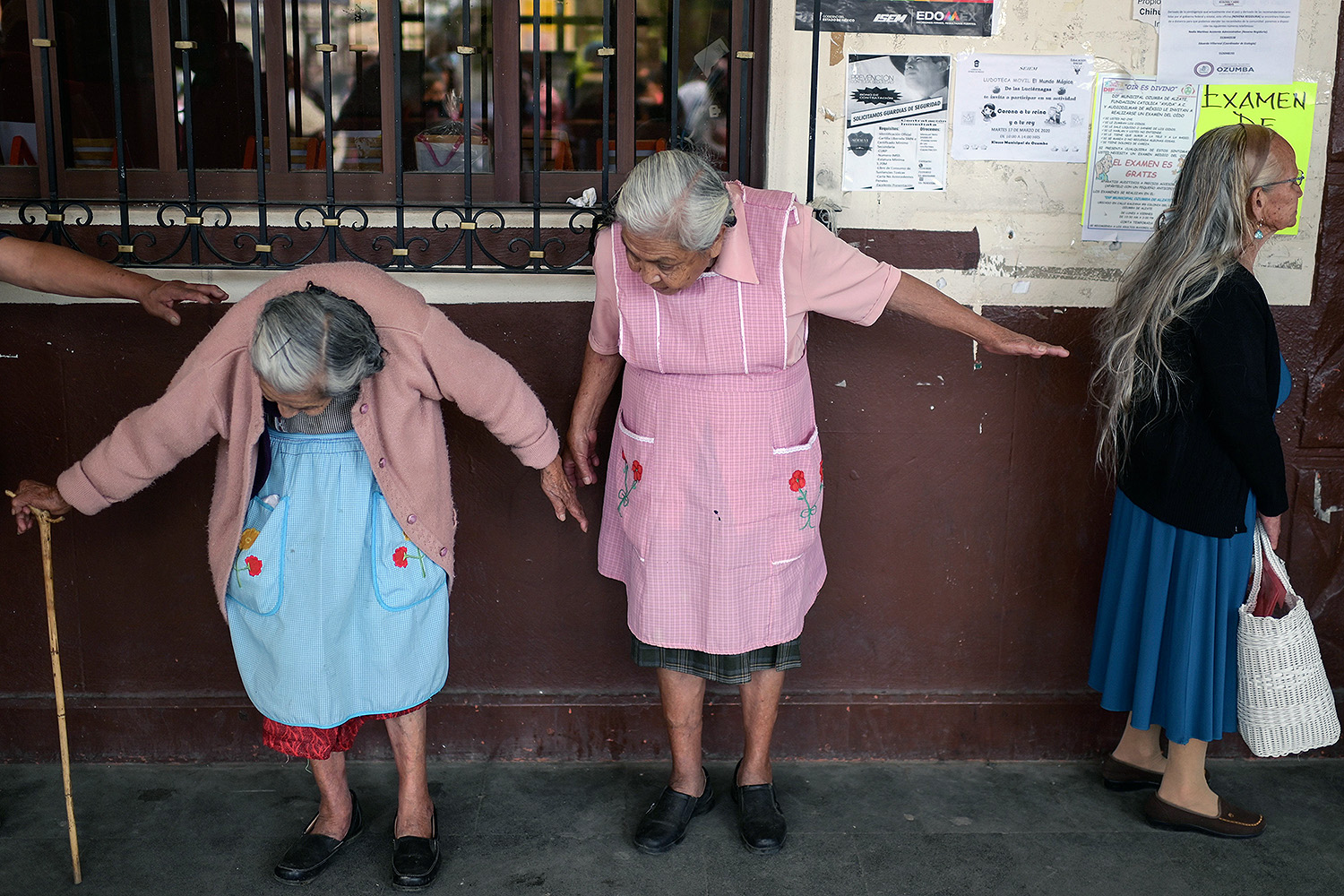 Elderly women try to keep up social distancing as they wait to enroll in government social-aid programs in Ozumba, Mexico, on April 3. PEDRO PARDO/AFP via Getty Images