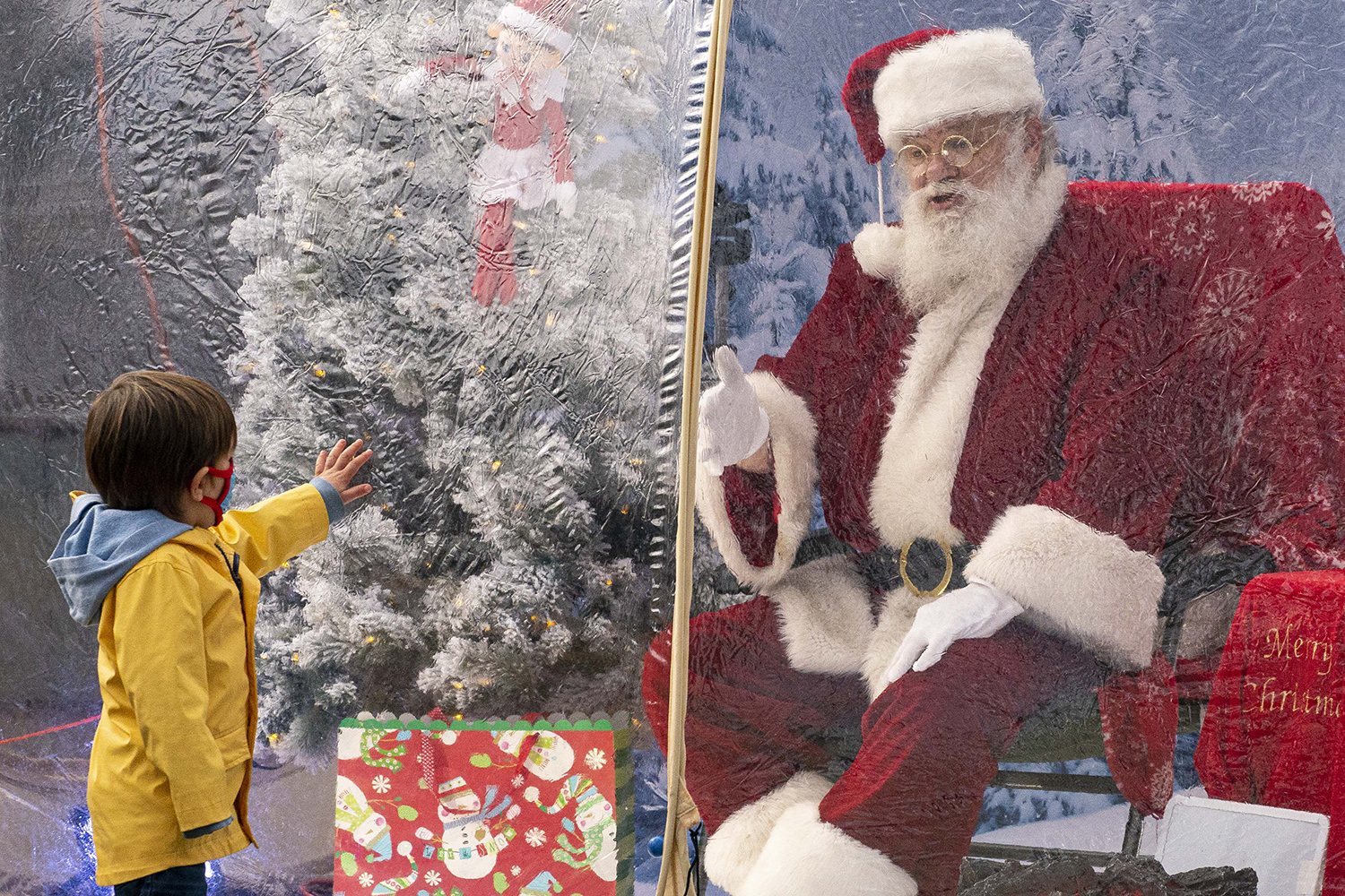Santa chats with a visiting child in Seattle, Washington, on Dec. 6. David Ryder/Getty Images