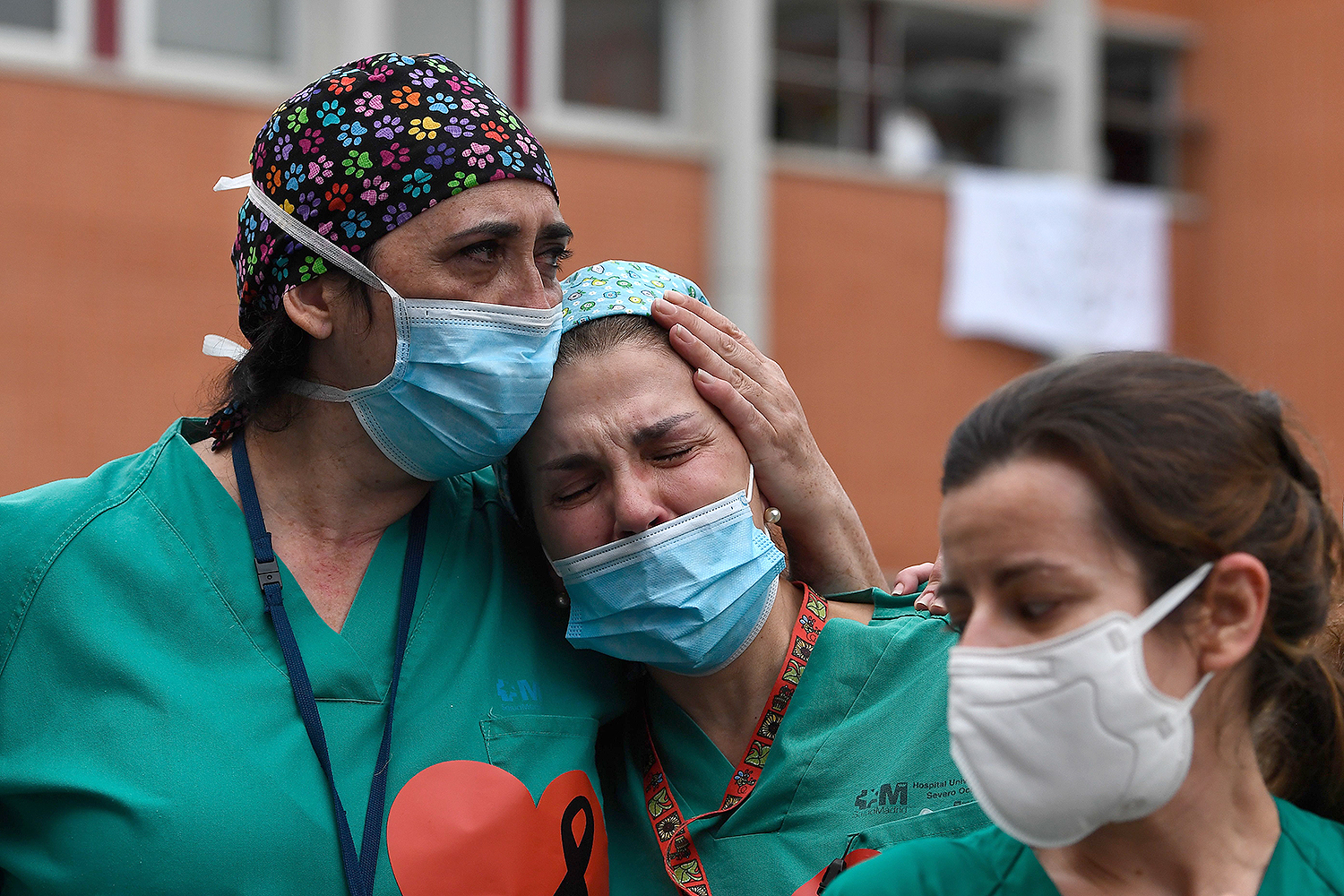 On April 10, health care workers mourn their co-worker Esteban, a nurse who died of the coronavirus at Severo Ochoa Hospital in Leganes, Spain. PIERRE-PHILIPPE MARCOU/AFP via Getty Images