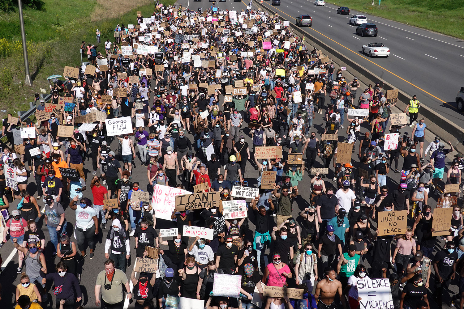 Demonstrators march along Interstate 94 in St. Paul, Minnesota, on May 31 in a protest against police brutality and the death of George Floyd. Scott Olson/Getty Images