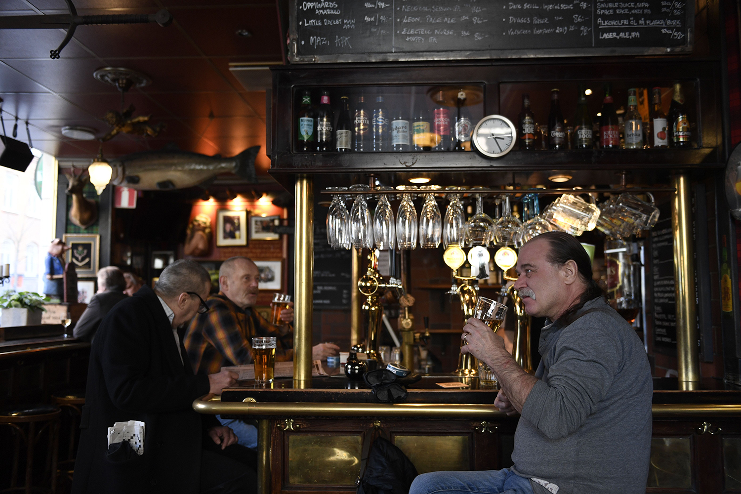 People gather for drinks at the Half Way Inn pub in central Stockholm on March 23. Sweden is the only democratic country in the world that does not recommend masks as the coronavirus pandemic continues.