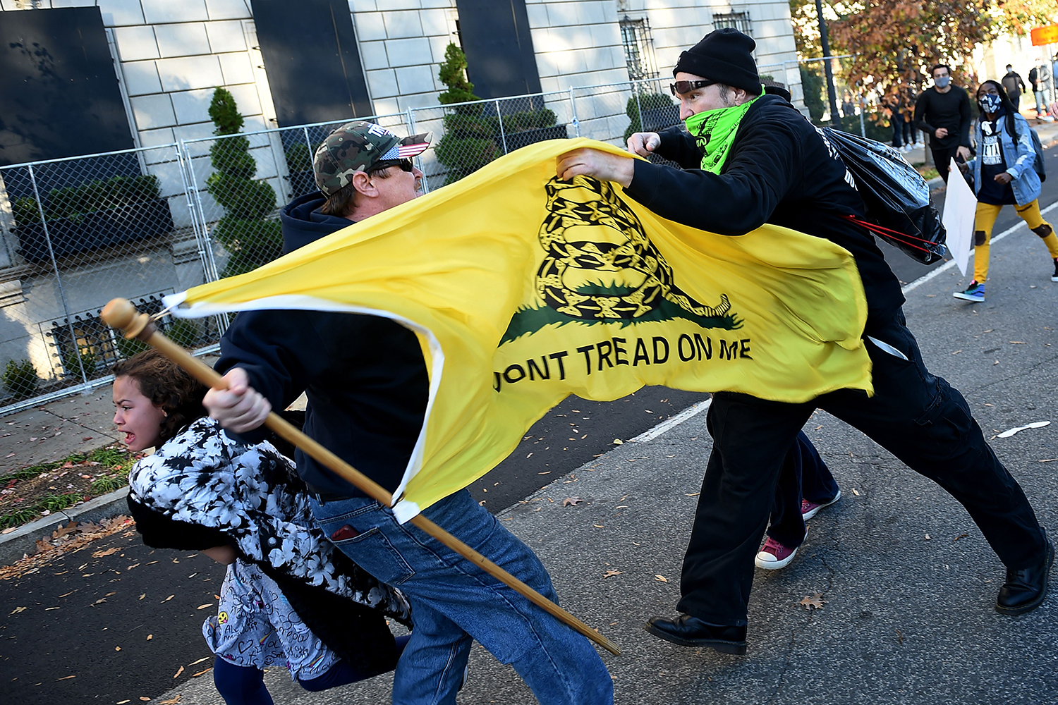 Counterprotesters clash with a supporter of U.S. President Donald Trump at a rally in Washington, D.C., on Nov. 14. OLIVIER DOULIERY/AFP via Getty Images