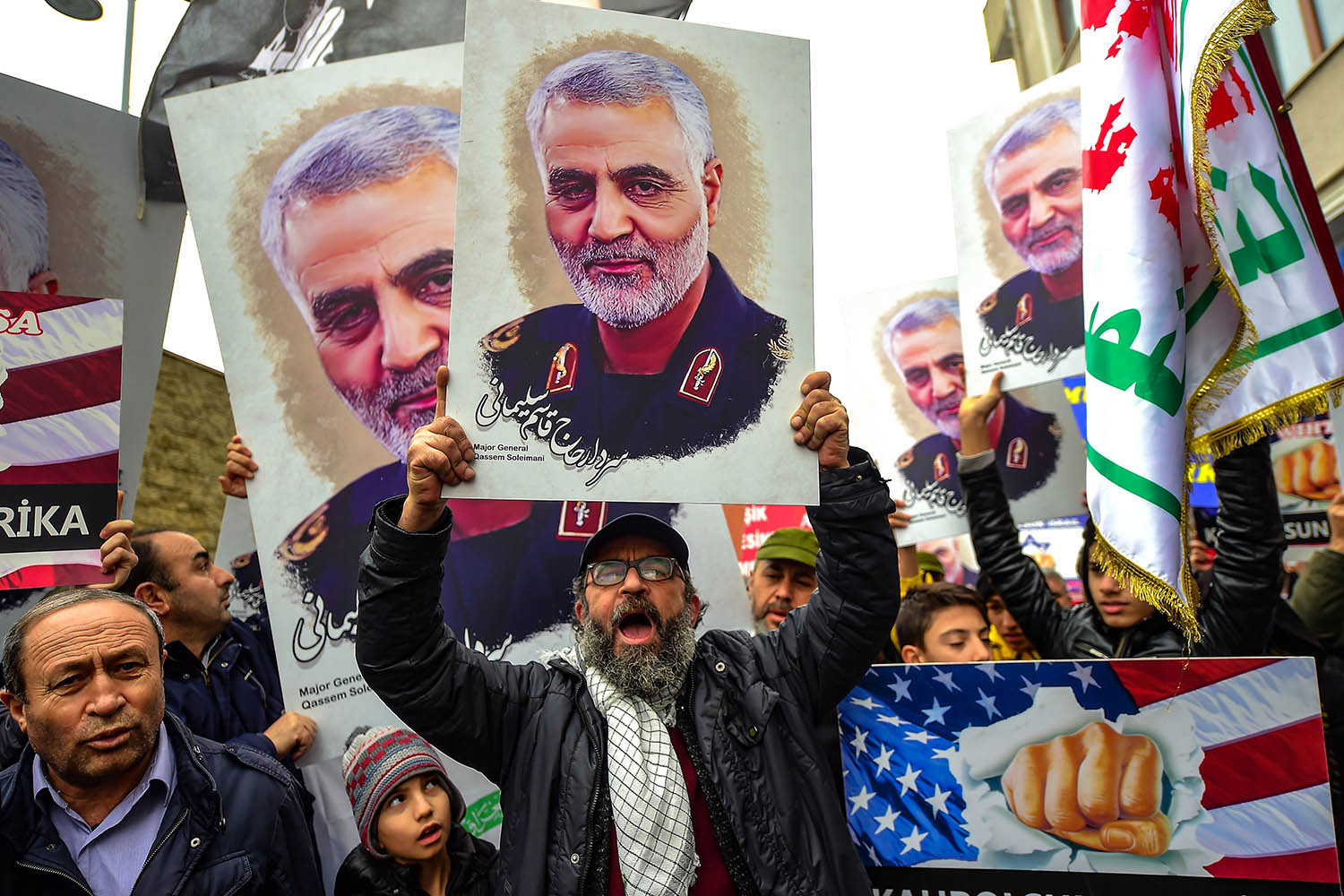 Protesters hold pictures of Suleimani during a demonstration outside the U.S. consulate in Istanbul, Turkey, on Jan. 5. YASIN AKGUL/AFP via Getty Images