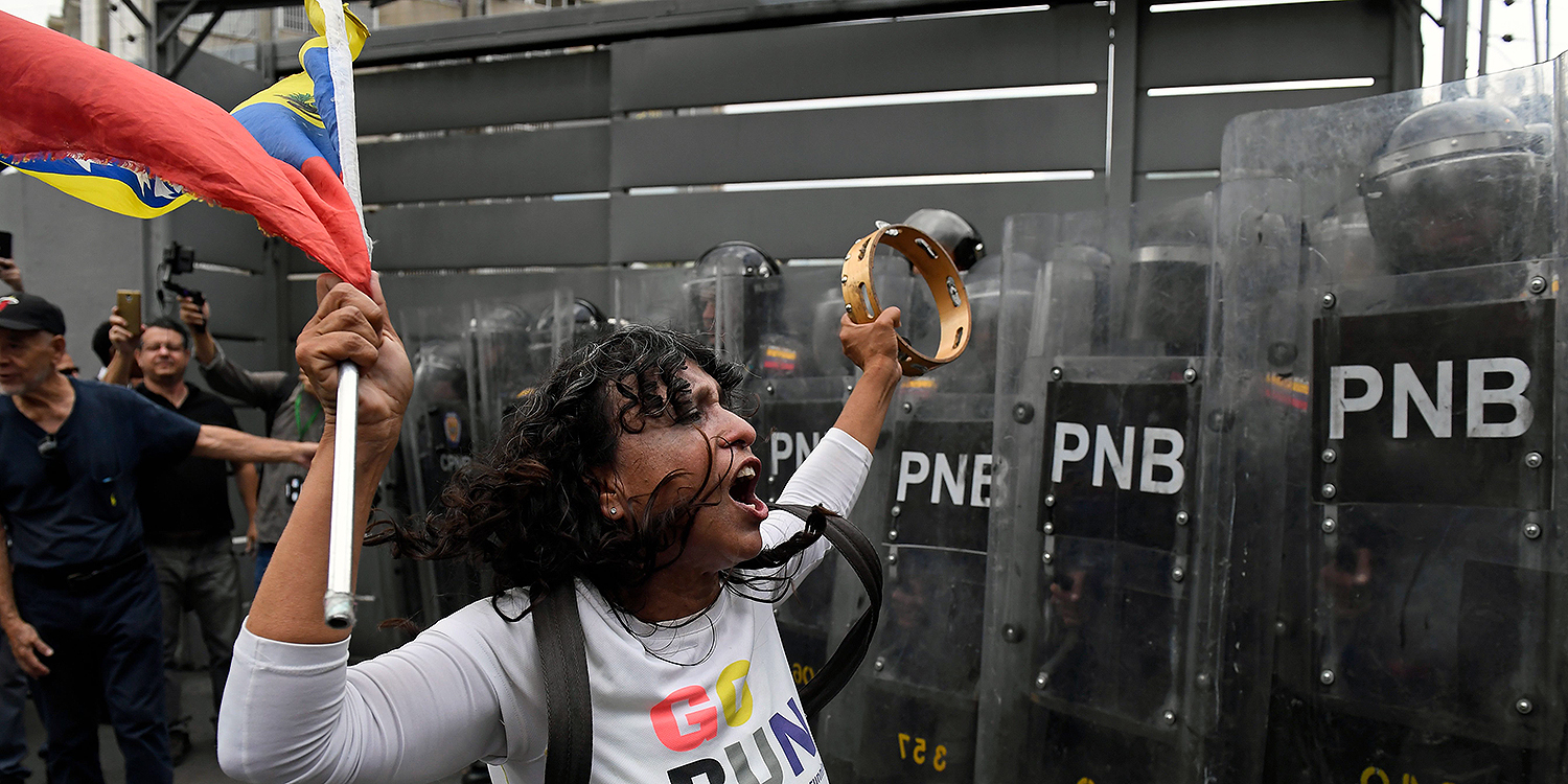 Supporters of Venezuelan opposition leader Juan Guaidó confront Venezuelan security forces preventing them from making their way to the National Assembly in Caracas on March 10.