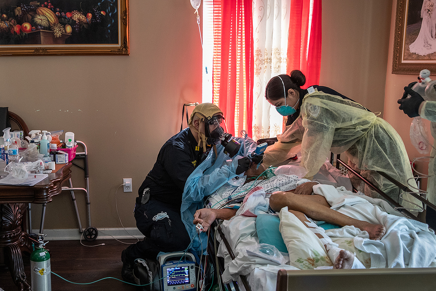 Medics intubate a patient with COVID-19 symptoms at his home in Yonkers, New York, on April 6. The man, 92, was barely breathing when they arrived. John Moore/Getty Images
