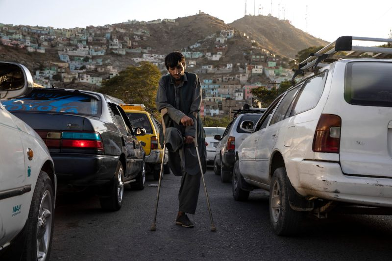 A beggar who said he lost his leg from a mine injury is seen in traffic on Sept. 21, 2019 in Kabul, Afghanistan.