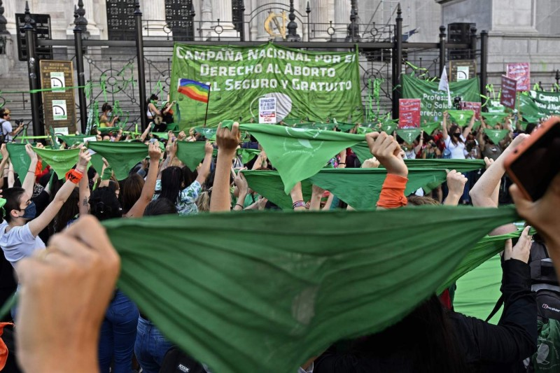 Activists hold up green headscarves during a demonstration outside the Congress building in Buenos Aires, on November 18, 2020,.