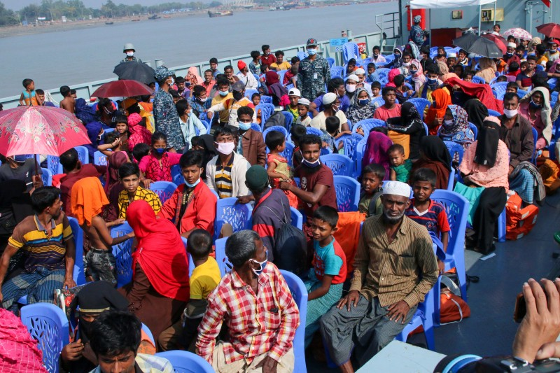 Rohingya refugees board a Bangladesh Navy ship to be transported to the island of Bhasan Char in Chittagong, Bangladesh, on Dec. 4.