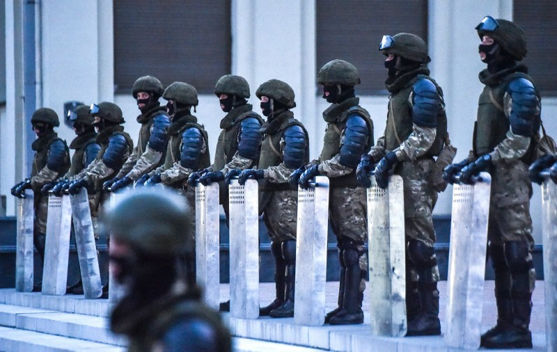 Belarusian police guard a government building during a protest rally against police violence in central Minsk on Aug. 14.